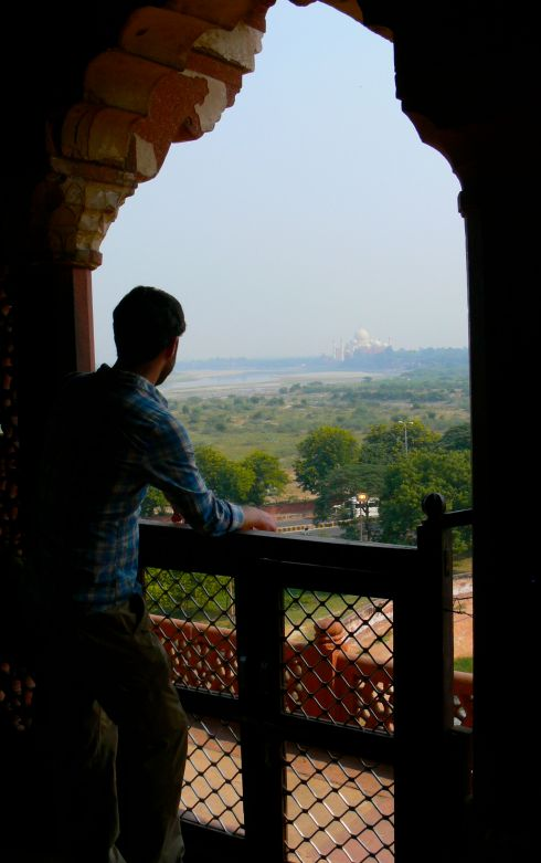 The boy at Agra Fort, with the Taj Mahal in the distance.