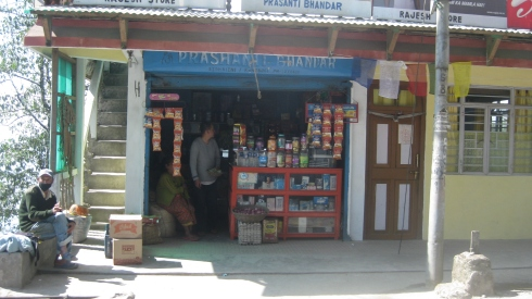 One of the many shops one passes a few feet away from on the Darjeeling-Kurseong route.